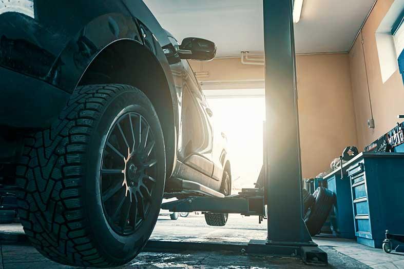 car on a mechanics lift
